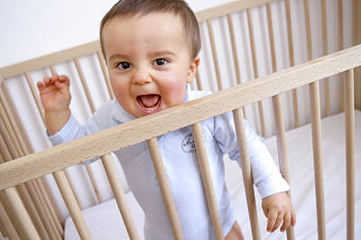 Child Care Photograph - Baby Boy In His Cot by Aj Photo