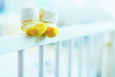 Booty Photograph - Baby Shoes On The Edge Of A Cot by Wladimir Bulgar
