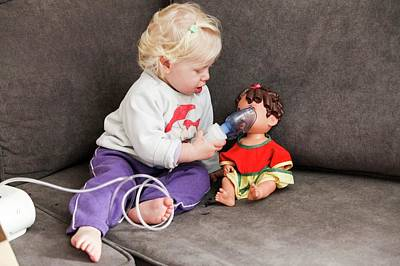 Doll Photograph - Baby Uses An Inhalation Mask On Her Doll by Photostock-israel