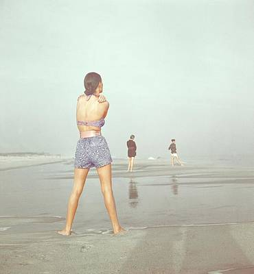 Back View Of Three People At A Beach Art Print