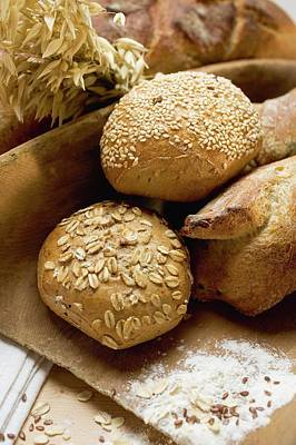 Wooden Ware Photograph - Baguettes And Wholemeal Rolls In Wooden Scoop In Front Of Tin Loaf by Foodcollection