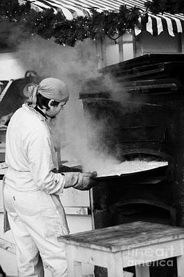 Baker Removing Tray Of Bread From An Outdoor Wooden Baking Oven On A Stall With Steam Escaping At The Christmas Market Berlin Germany Art Print