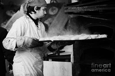 Baker Removing Tray Of Bread With Steam Rising From An Outdoor Wooden Baking Oven On A Stall At The Christmas Market Berlin Germany Art Print