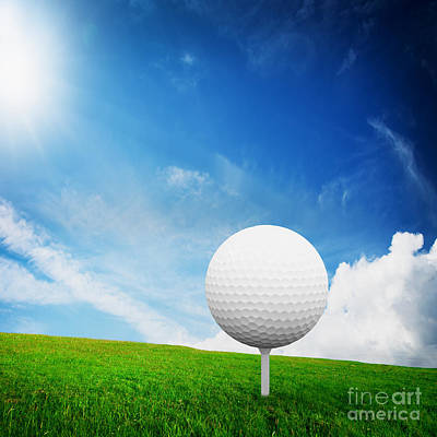 Sports Royalty-Free and Rights-Managed Images - Ball on tee on green golf field by Michal Bednarek