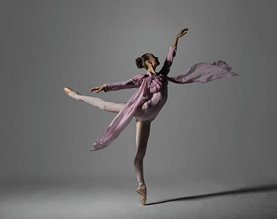 Photograph - Ballerina Performing Arabesque On Pointe by Nisian Hughes