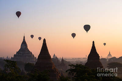 Religious Photograph - Ballons Over The Temples Of Bagan At Sunrise - Myanmar by Matteo Colombo
