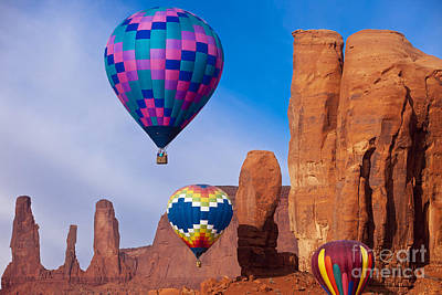 Photograph - Balloon Festival In Monument Valley by Brian Jannsen