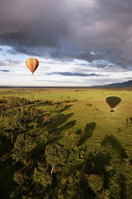 Balloon In Masai Mara National Park Art Print by Luis Davilla