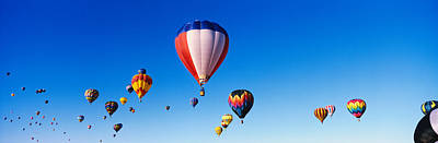 Hot Air Balloon Race Photograph - Balloons Floating In Blue Sky by Panoramic Images