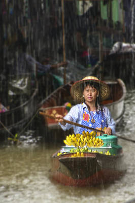 Print featuring the photograph Banana Vendor In The Rain by Rob Tullis