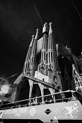 barcelona open topped bus city tour going past Sagrada Familia Barcelona Catalonia Spain Print by Joe Fox