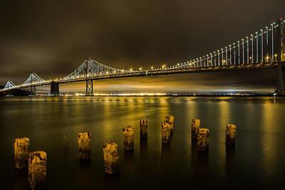 Bay Bridge And Clouds At Night Art Print by John Daly