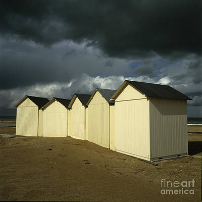 Beach Photograph - Beach Huts Under A Stormy Sky In Normandy. France. Europe by Bernard Jaubert
