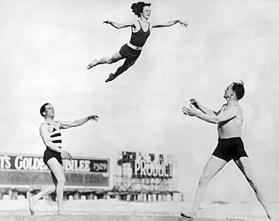 Athlete Photograph - Beach Performers Toss Woman by Underwood Archives