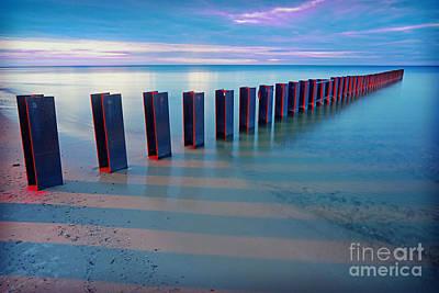 Beach Pylons At Sunset Art Print