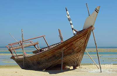 Dhow Photograph - Beached Dhow At Wakrah by Paul Cowan