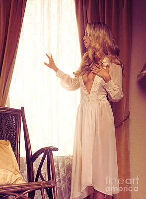 Beautiful Blond Woman In Night Gown Looking Out Of The Window Art Print