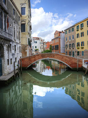 Beautiful Reflections Of Bridge In Canal In Venice Italy Art Print by Matthew Gibson