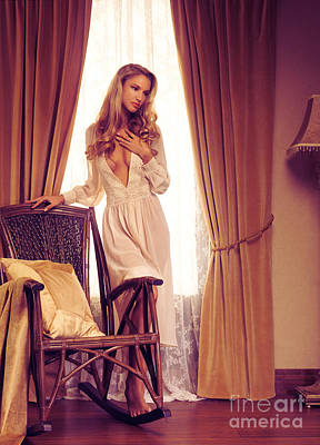 Rocking Chairs Photograph - Beautiful Sensual Woman Standing At A Window by Oleksiy Maksymenko