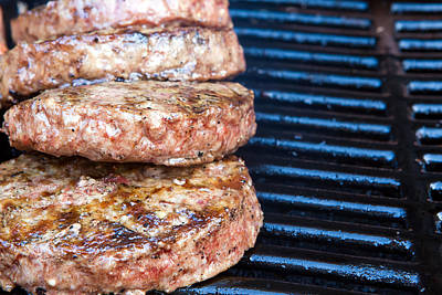 Beef Quarterpounder Burgers Begin To Cook On The Gas Barbecue Art Print by Fizzy Image