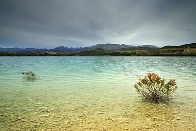 Landscape Photograph - Bermejales Lake Before The Storm by Guido Montanes Castillo
