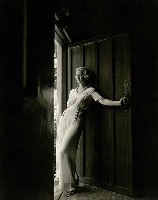 1930s Fashion Photograph - Bette Davis Standing In A Doorway by Maurice Goldberg