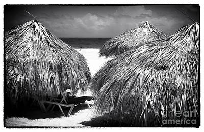 Photograph - Between The Huts by John Rizzuto