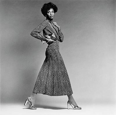 Black And White Photograph - Beverly Johnson Wearing A Chevron Striped Dress by Francesco Scavullo