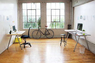 Bicycle And Desks In Modern Office Art Print by Sam Diephuis