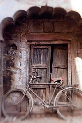 Adam Photograph - Bicycle In Doorway, Jodhpur, Rajasthan by Peter Adams