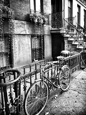 Interior Scene Photograph - Bicycle In The Village by John Rizzuto