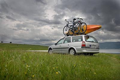 Bicycles And Kayak On A Car At A Lake Original