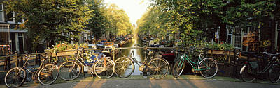 Bicycles On Bridge Over Canal Art Print by Panoramic Images