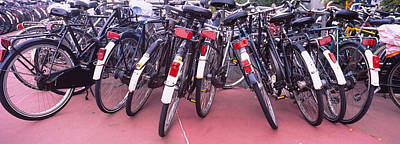 Conformity Photograph - Bicycles Parked In A Parking Lot by Panoramic Images