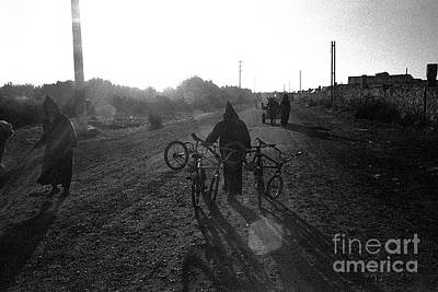 Photograph - Bicycles by Samuel Wooten