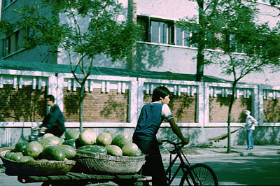 Photograph - Bicyclist With Baskets Of Watermelons by John Warren