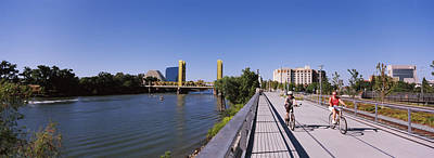 Sacramento Photograph - Bicyclists Along The Sacramento River by Panoramic Images