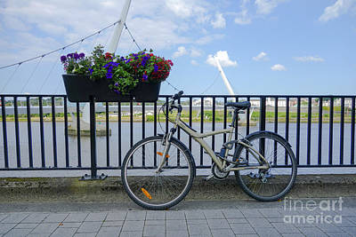 Photograph - Bicyle Against Railings by Jim Orr