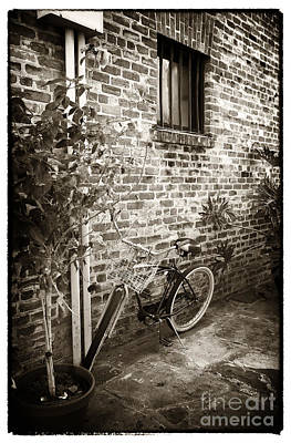 Bike In Pirates Alley Art Print by John Rizzuto