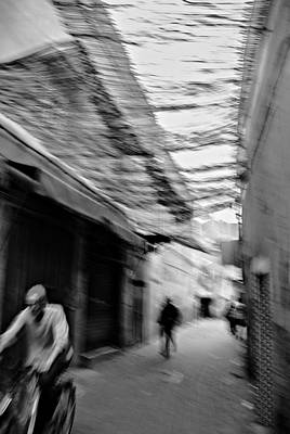 Photograph - Bike Rider In The Souk by Ellie Perla