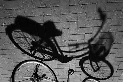 Photograph - Bike Shadow Flipped by Lauren Rathvon