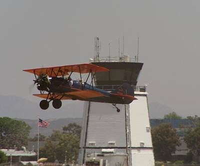 Photograph - Biplane Take Off by Phyllis Spoor