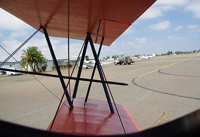 Photograph - Biplane Taxiing Out by Phyllis Spoor