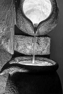 Photograph - Black And White Water Pouring Forth From Large Stone Pots by Valerie Garner