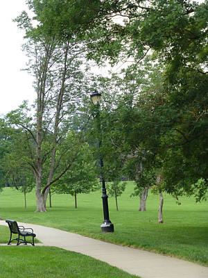 Photograph - Black Bench And Lightpost by Claudia Goodell