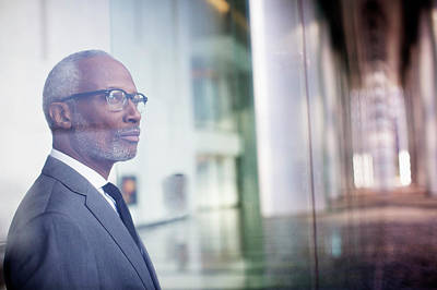 Black Businessman Looking Out Window Art Print by Hill Street Studios Llc