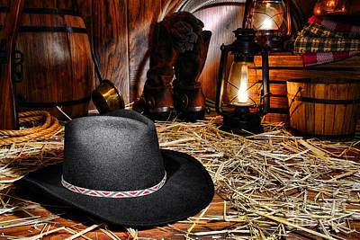 Black Cowboy Hat In An Old Barn Art Print by Olivier Le Queinec