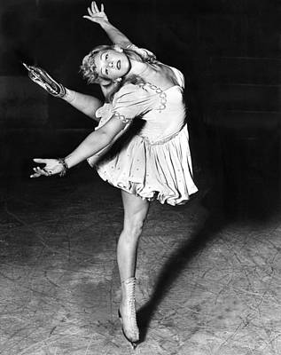 One Leg Photograph - Blond Ballerina Of The Rinks by Underwood Archives