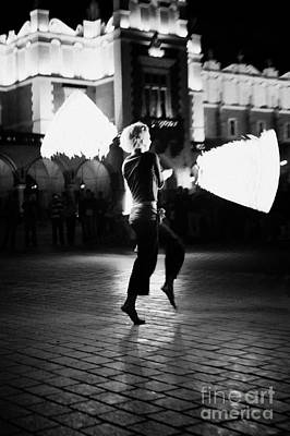 Cracovia Photograph - Blonde Female Fire Dancer Street Entertainer Dances With Fire In Front Of The Cloth Hall In Krakow by Joe Fox