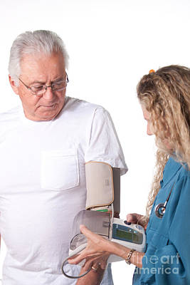Photograph - Blood Pressure Test In Hospital by Gunter Nezhoda